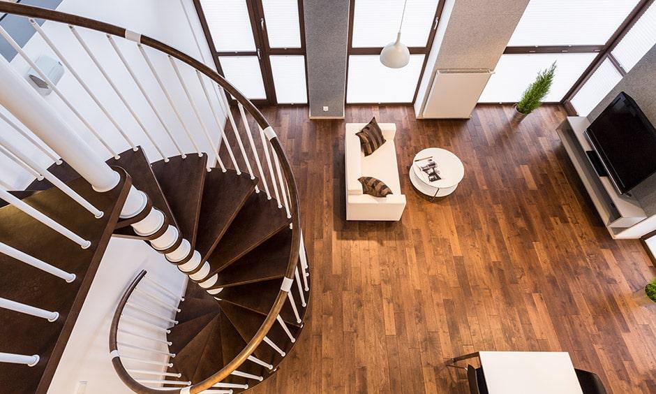 Modern staircase design with a circular wooden staircase