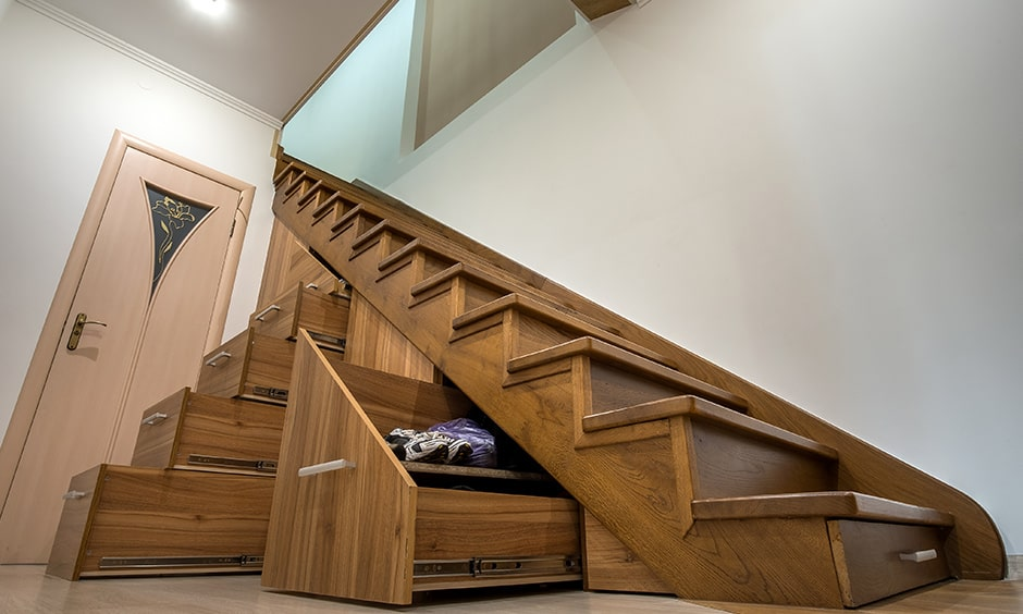 Modern wooden staircase with storage drawers makes great use of free space under stairs