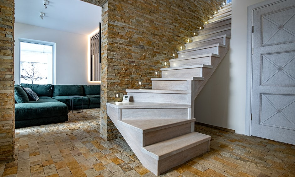 Rustic white wooden staircase design with unusual stone walls