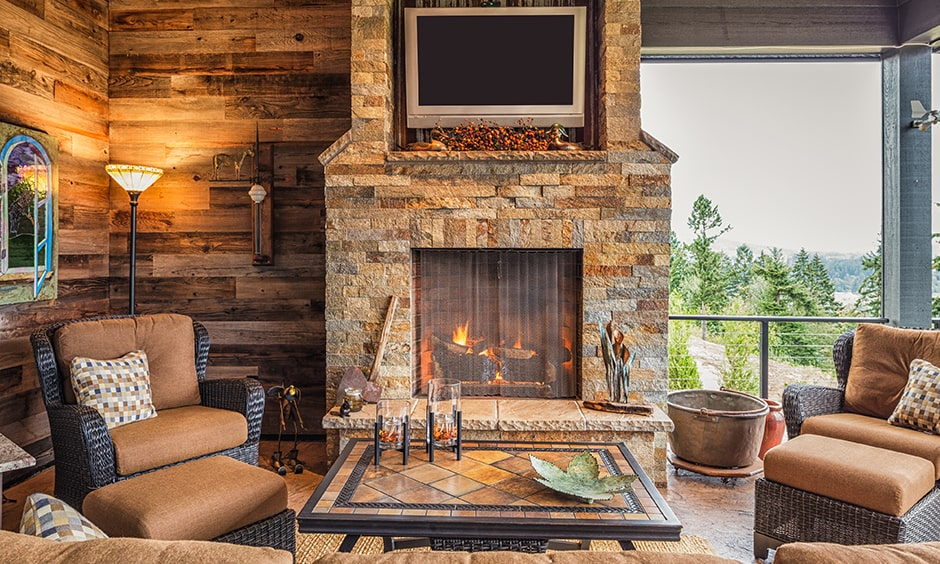 Organic fireplace design with earthy stones, wood and metal screens