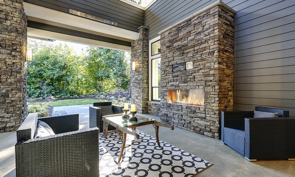 Fireplace design with stone materials gives an authentic, indie touch to your seating area