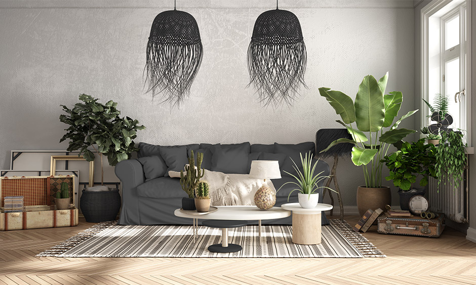 Boho grey rustic living room with plants, rugged textiles, and chic furniture which is great for spacious homes