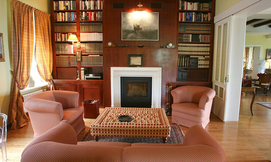 Home library ideas with a sweet cosy home library with a fireplace