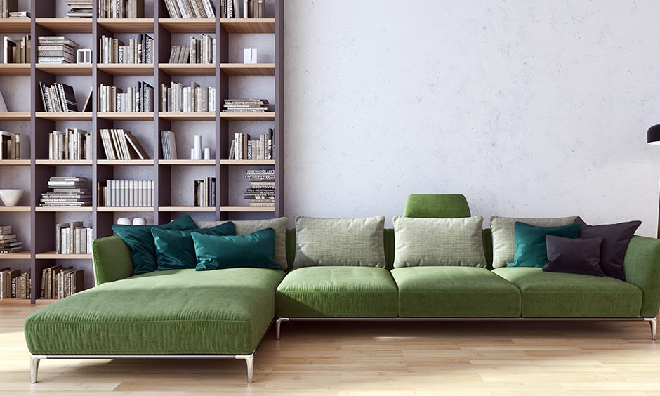 Home library interior design with l-shaped sectional sofa and plush pillows