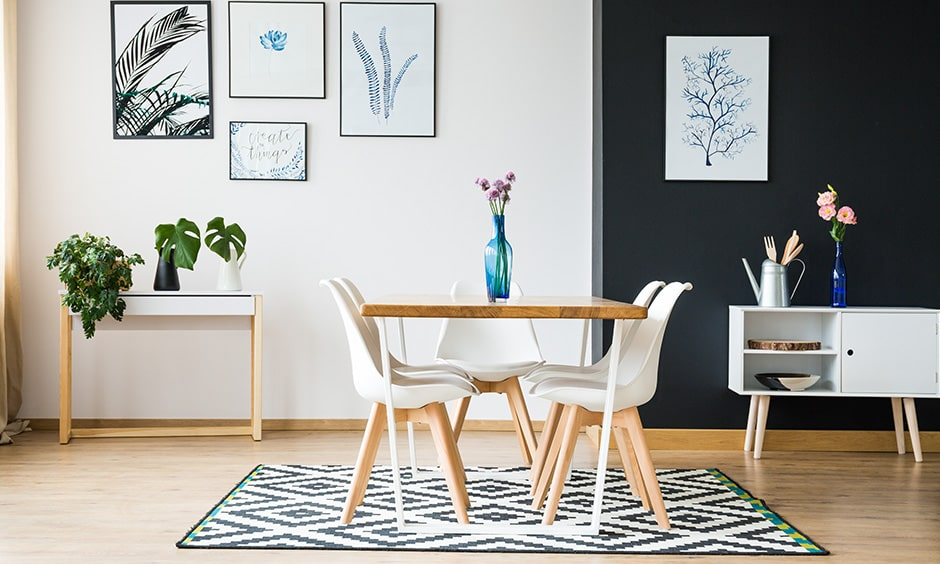 Decor for small dining room with a stylish rug and a minimal vase with fresh flowers