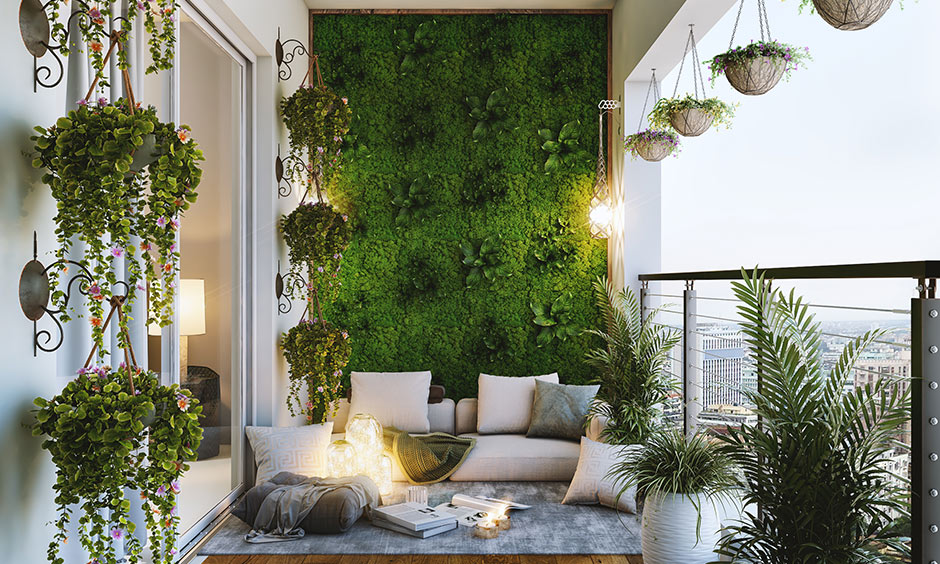 Cover balcony with lush plants, flower pots, a grass wall, and add comfortable seating spot great small balcony ideas.