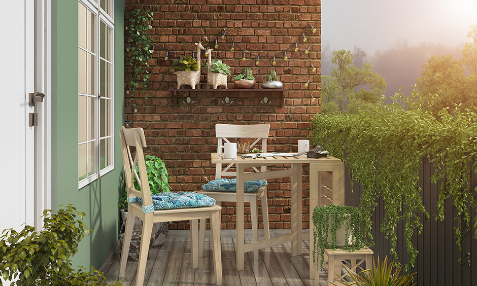 A folding table with comfortable chairs is an excellent idea for small open balcony ideas.