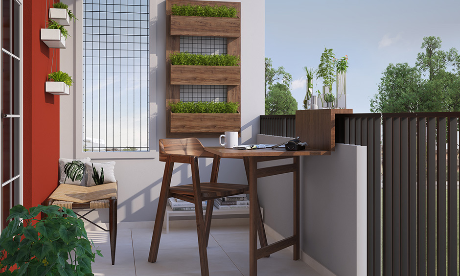 Folding chair and table can move quickly around as it is lightweight by nature are the best balcony design for small house