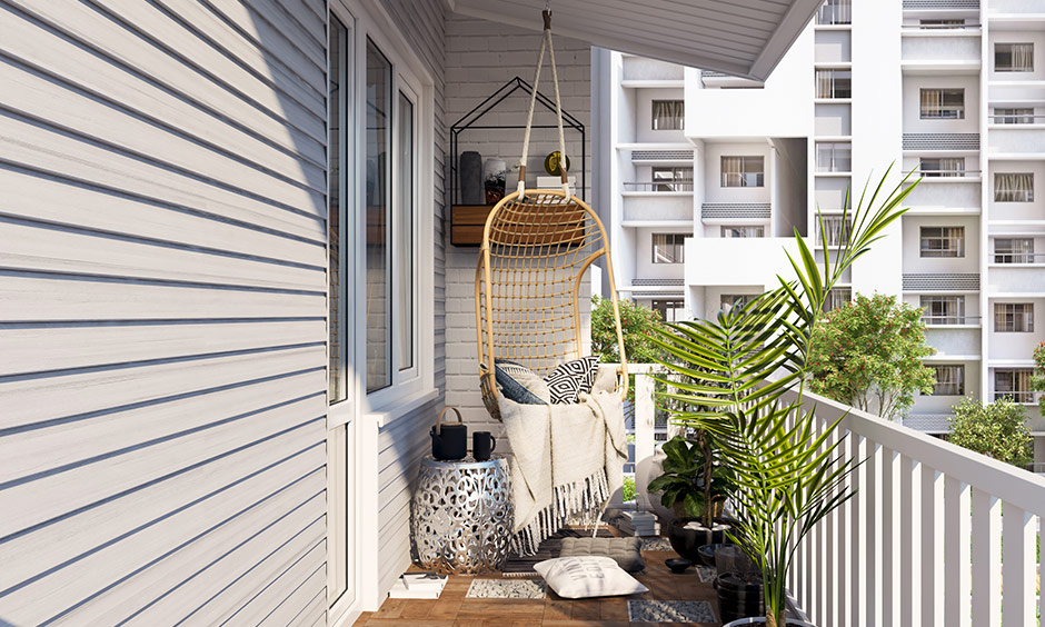 A chic hammock or a fun swing will give your small balcony a laid-back vibe is a great small balcony design