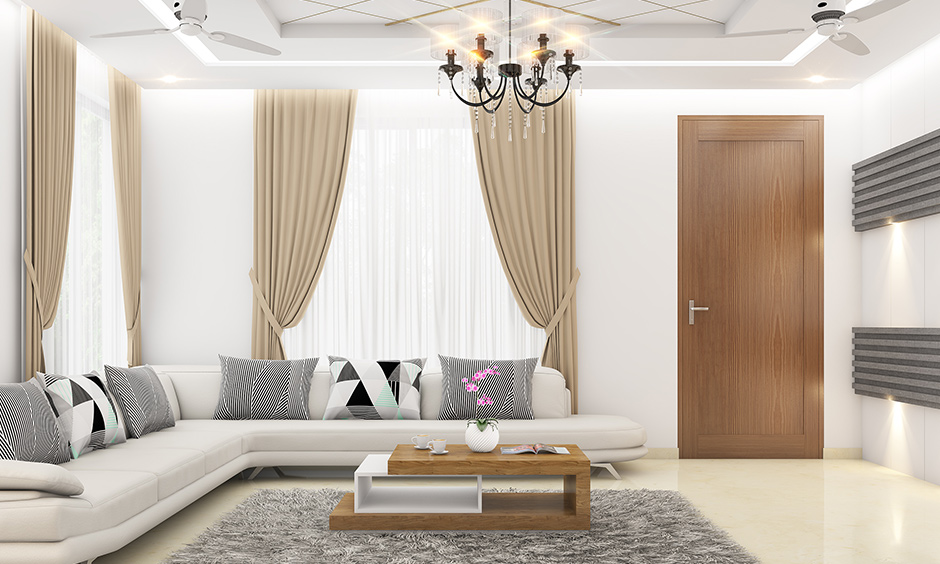 Fancy white living room with a modern l-shaped sectional sofa in white leather