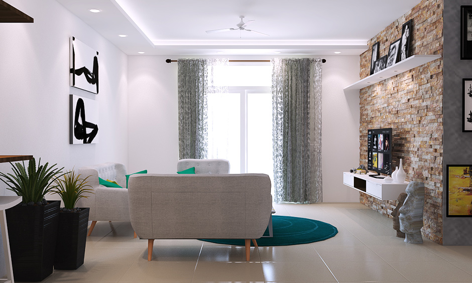 A dare devils decision with white walls living room where  abstract art on the wall adds in the chic and edgy quotient