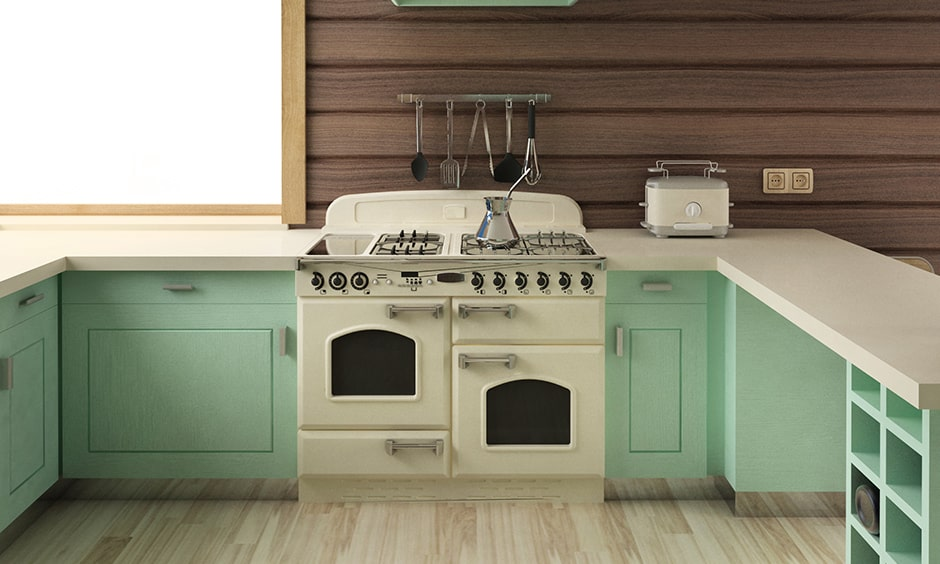 Retro kitchen design in pastel green with dual ovens