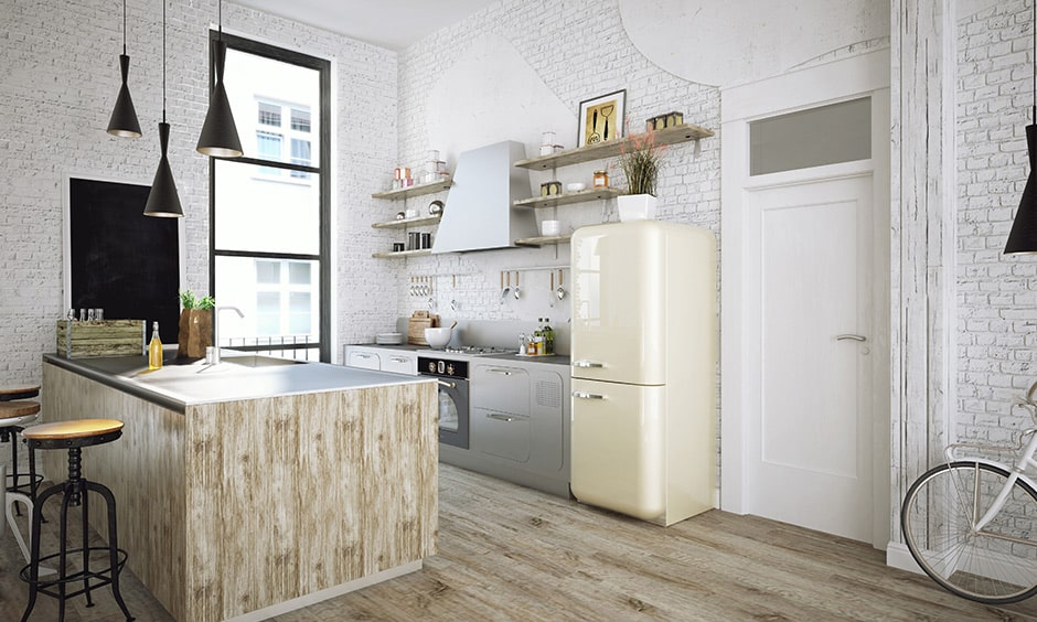 Retro kitchen with a 90's look with a brick wall and single steel oven