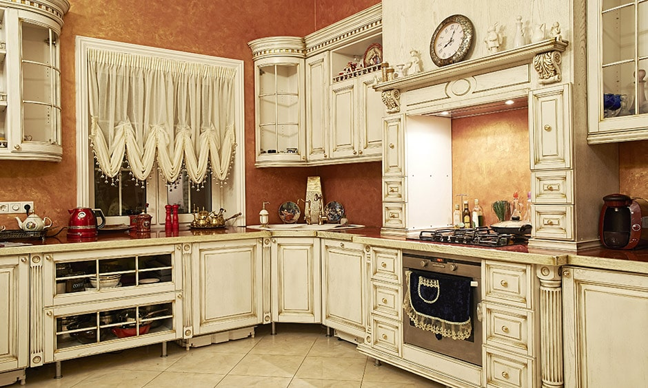True vintage kitchen design with white interior and lace curtains