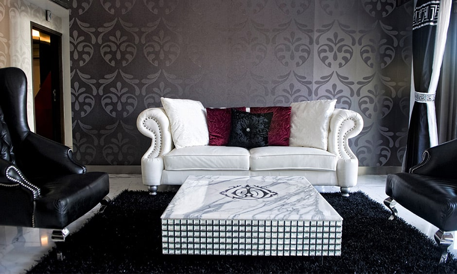 Dark grey themed living room design with dark-grey floral patterned wall