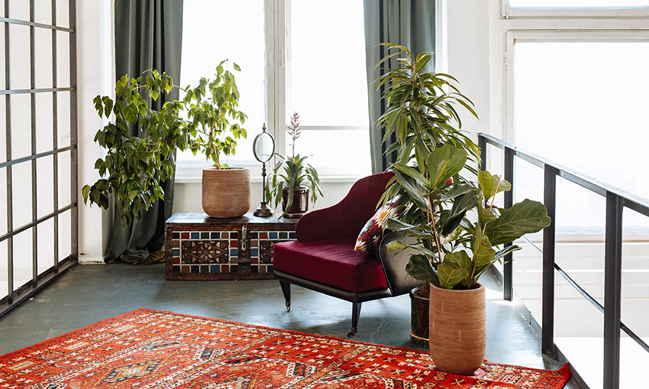 What is bohemian style with a bright patterned rug like this one instantly lifts a room
