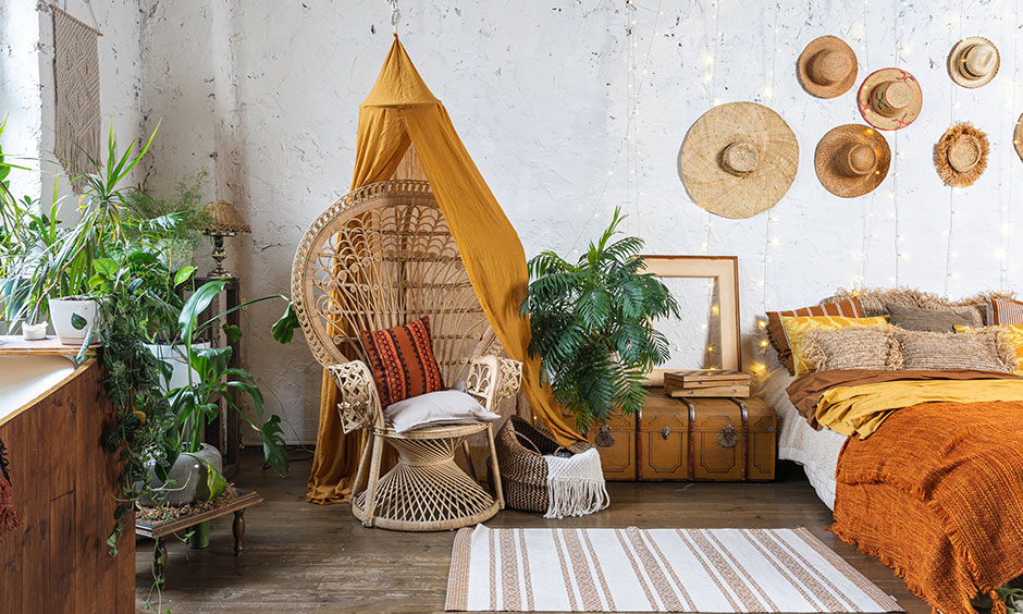 cane armchair and hats hanged on wall is bohemian decor ideas for your home