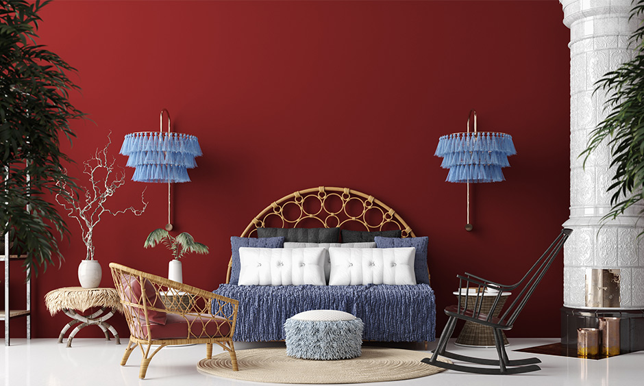 Breakrules with bohemian home decor ideas with a deep red wall and lampshade with powder blue tassels