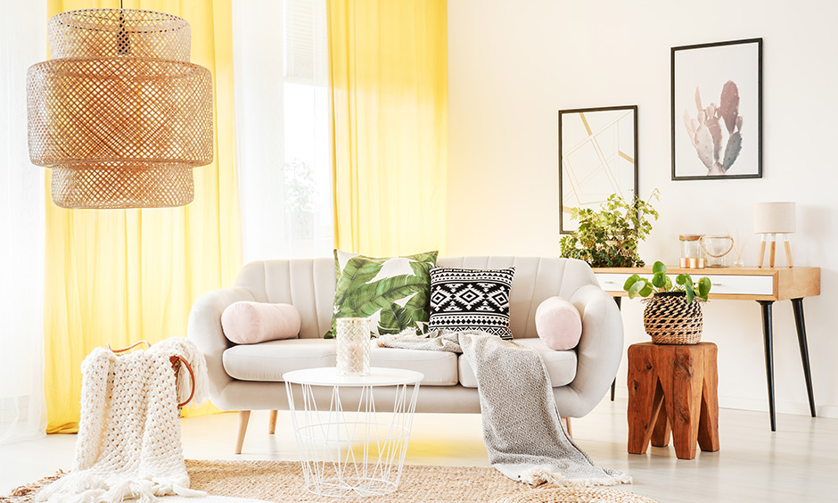 Unique bohemian design with canary yellow curtains and furniture in neutral colours