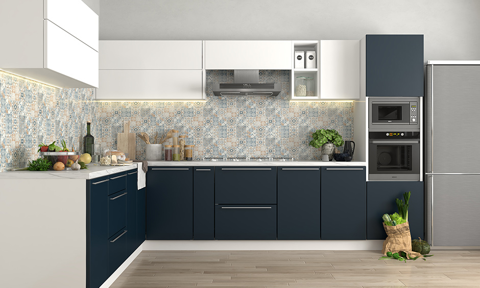 Blue and cream kitchen ideas, solid blue kitchen units and with a multi-coloured tile design on the walls look spacious.