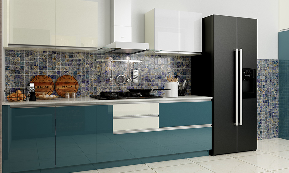 Patterned blue square tiles on the wall match well with the blue kitchen furniture and are a good option.