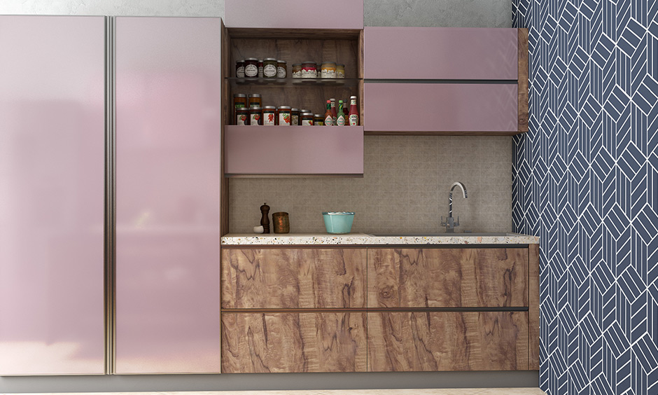 Blue kitchen colours wall with pink kitchen cabinets to be trustworthy, loyal and friendly.