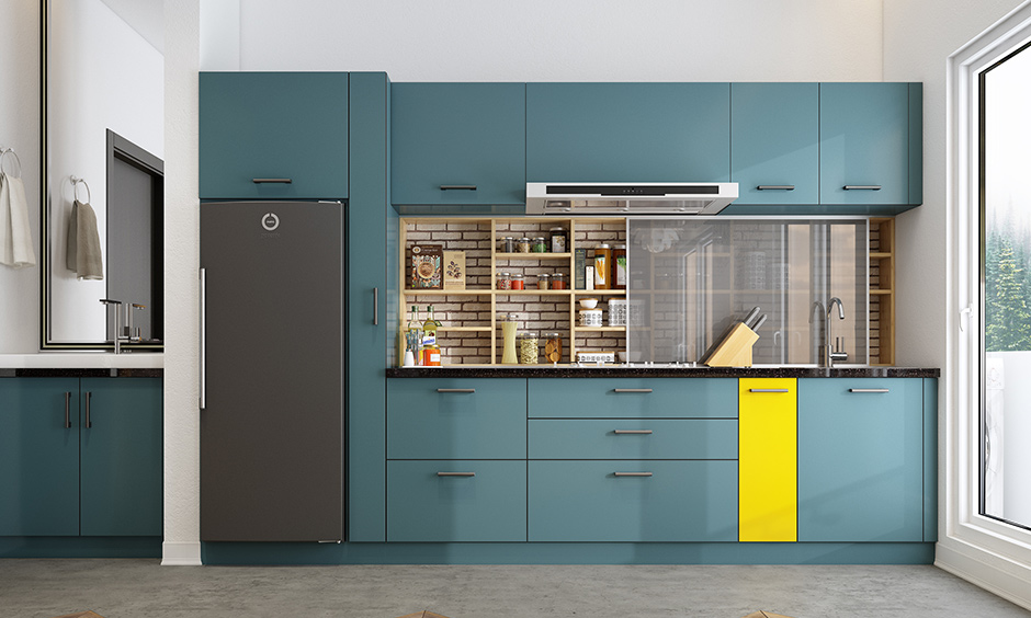 Teal blue kitchen units with a punch of yellow create an impactful impression and a very vibrant space!