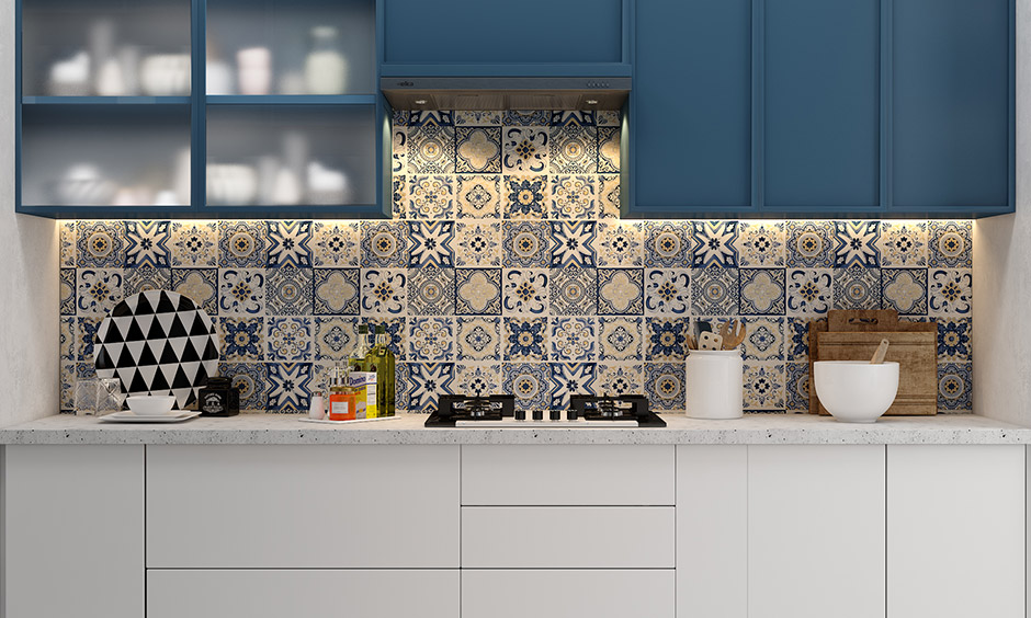 Go for solid blue kitchen units and add fun to the area with blue kitchen walls and floor in different tile designs.