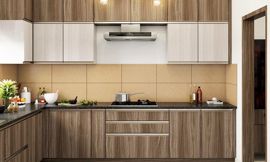 Antique oak kitchen design with the beige-color tiled backsplash and the black granite countertop