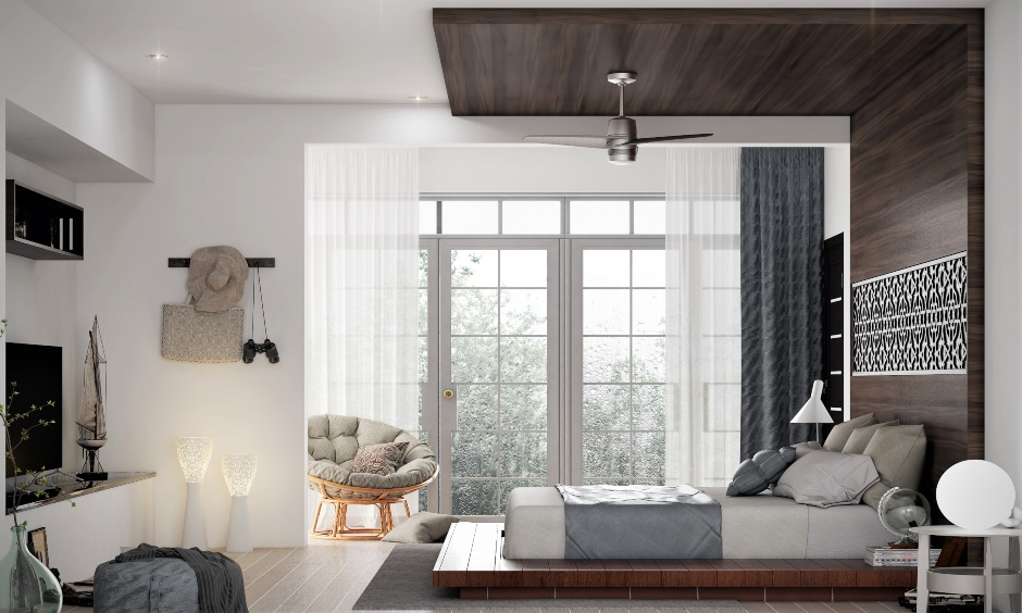 Wooden low floor bed that lies within a frame extending across the wall right up to the ceiling.