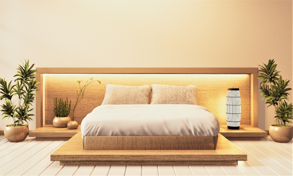 Japanese-style low floor double bed designs with natural-toned colours of the frame and mattress look peaceful
