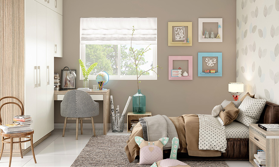 Cool dorm room ideas, picture-framed shelves add a pop of playful colours & chair becomes your go-to-place for chilling.