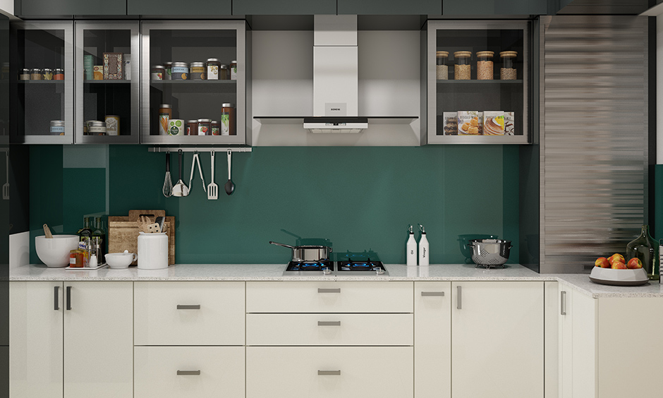 Plain green backsplash with grey cabinet and white wardrobe design in kitchen gives space a modern look