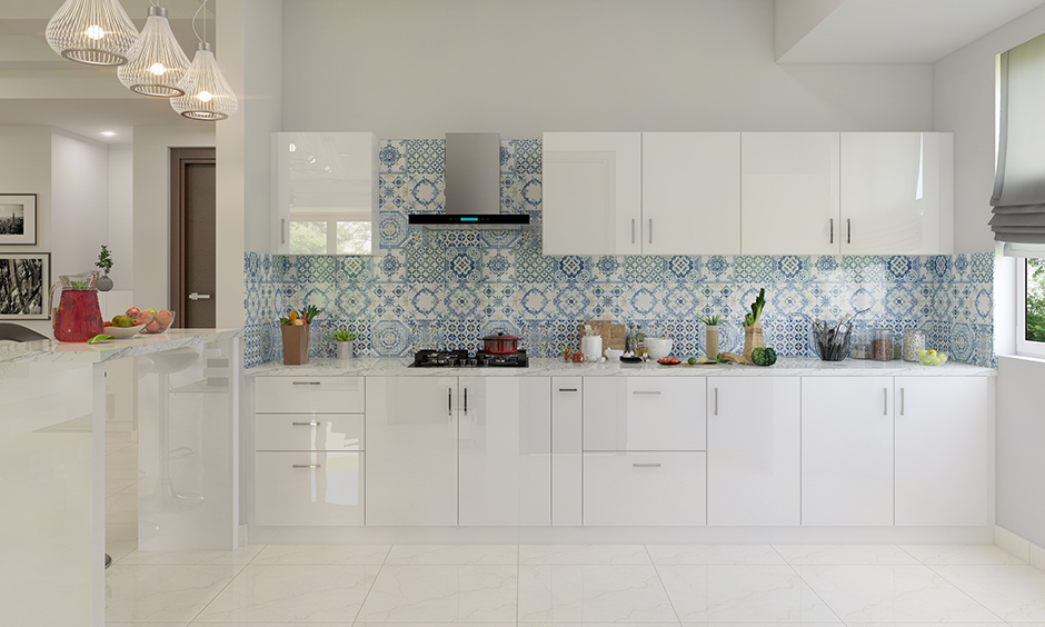 Italian finish design of kitchen wardrobe with all-white and patterned tiles for the backsplash beautifully break.