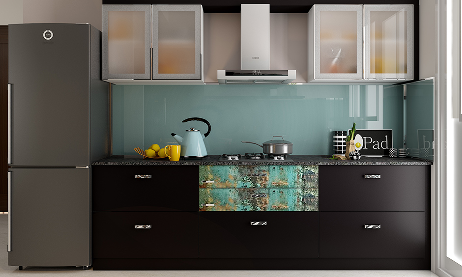 Compact modular kitchen and wardrobe designs with black laminate take care of form and functionality in small space.