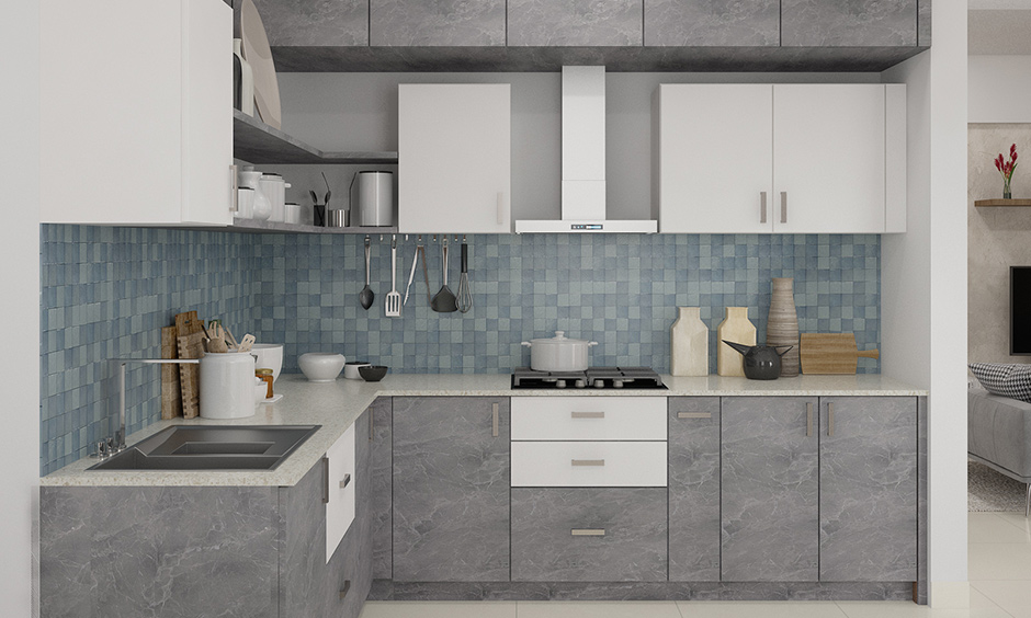 Blue chequered backsplash kitchen wardrobe design with a combination of grey marble finish & white laminate looks soothing