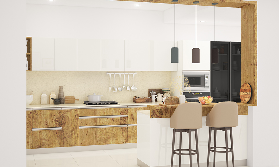 Open white kitchen with wooden wardrobe designs for kitchen makes space interactive in nature.
