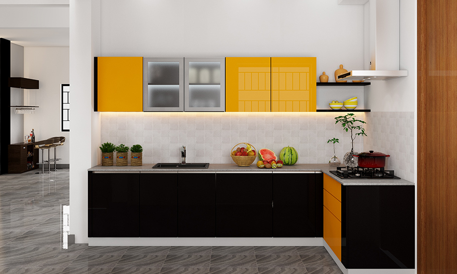 Simple kitchen wardrobe design with a combination of yellow and black laminate highlights the open kitchen.