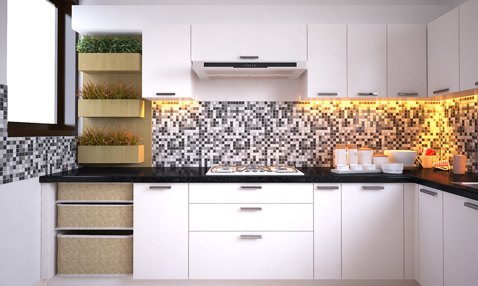 Best kitchen wardrobe designs with monochrome & square backsplash always work its magic.