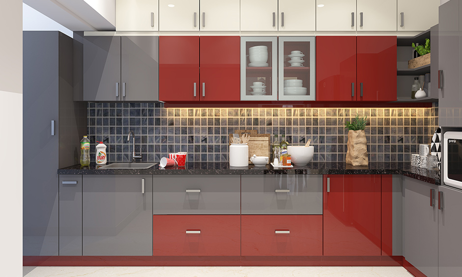 Kitchen wardrobe colour like red instantly enhances a colour combination of dull grey and white kitchen cabinets.
