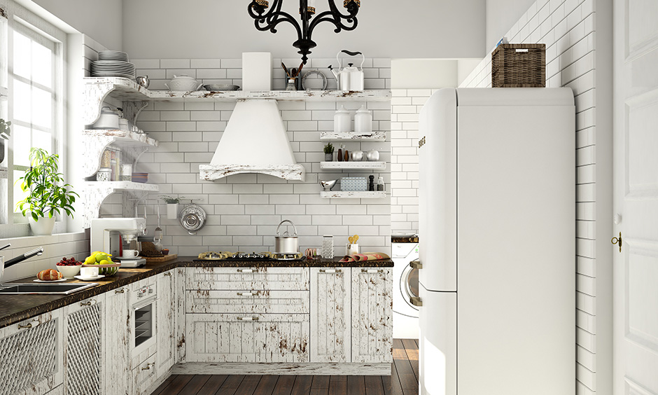 White small kitchen wardrobe designs with rustic wooden finish, unique shelf design and wooden flooring look soothing.