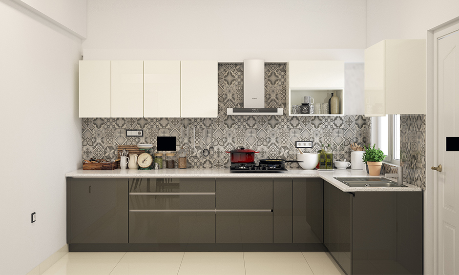Modular kitchen wardrobe designs in grey look alluring with patterned backsplash and the touch of white.