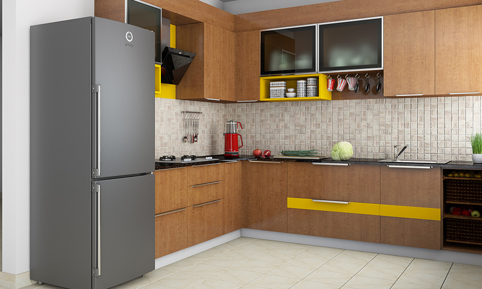 Wooden wardrobe designs for kitchen with a hint of yellow colour adds a modern twist to kitchen wardrobe.