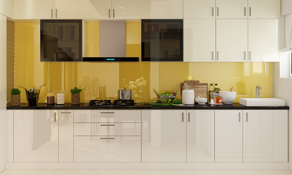 Background sunny yellow modular kitchen and wardrobes with white laminate brighten things up.