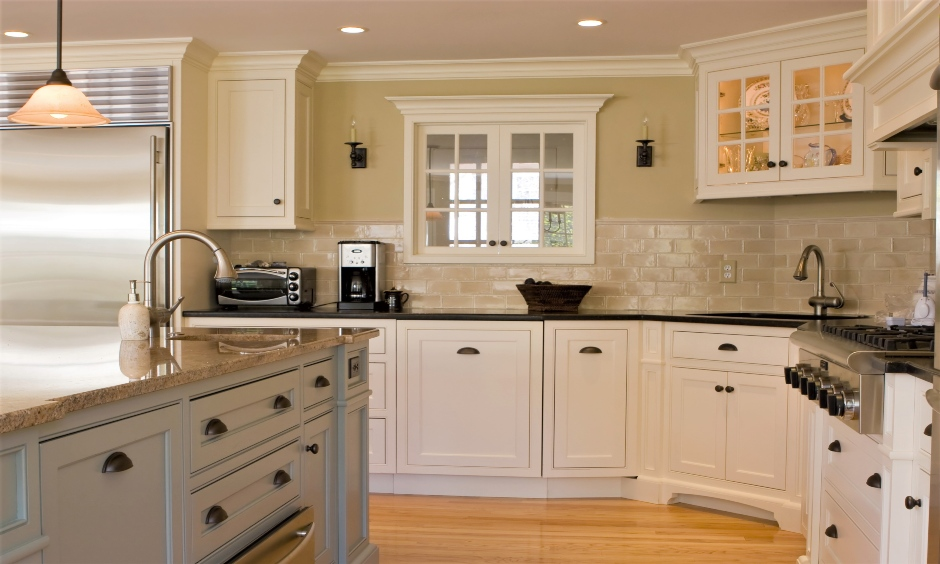 Corner kitchen sink cabinet with glass-doored looks traditional and classy.