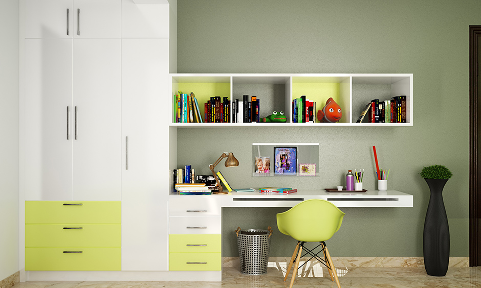 Yellow & white study tables with wall mounted bookshelves are great options for book storage for a kids room.