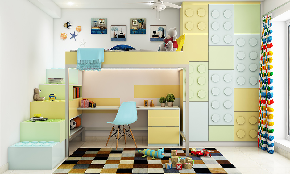 A large wardrobe next to only the top bunk and study at the bottom is perfect for saving space are kids room storage ideas.