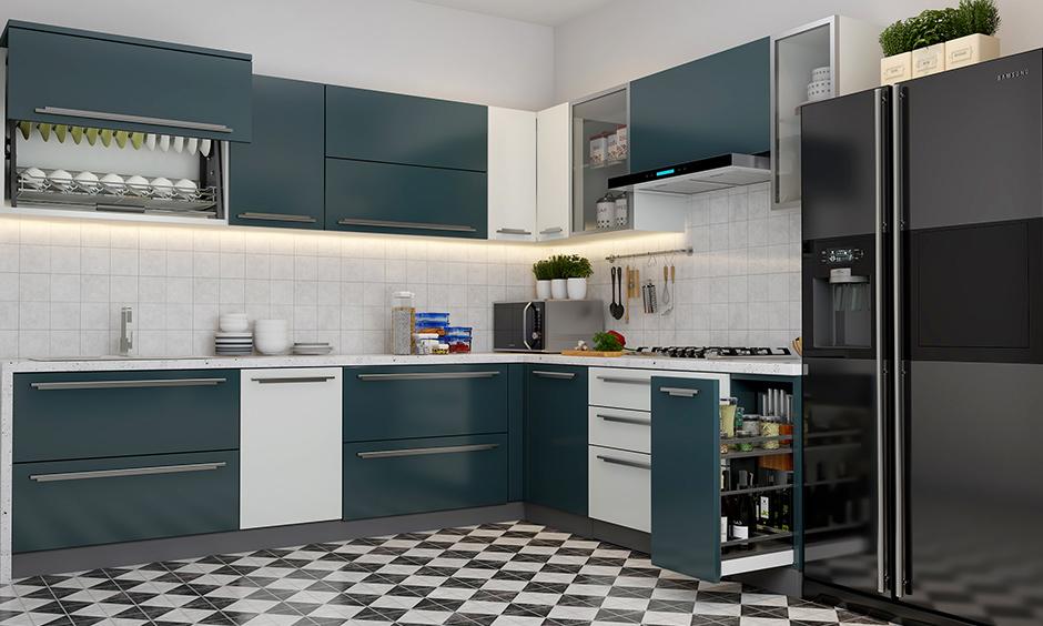 White and bluish corner kitchen unit design utilised with smart storage units, so space does not go waste.