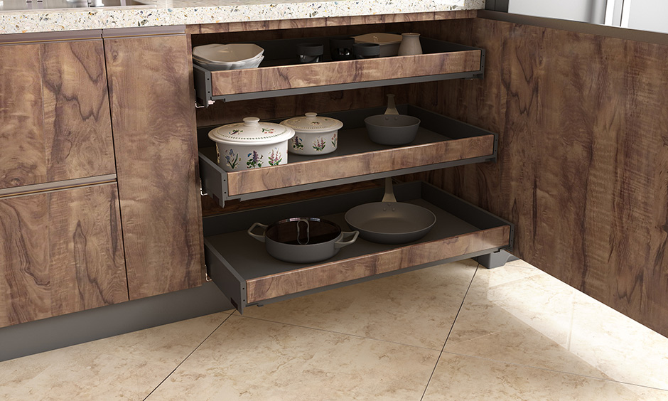 Wooden internal drawers base kitchen unit is capable with ample storage space to organise utensils look clean and elegant.