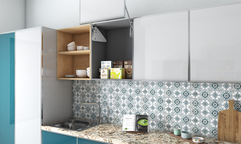 This white vertical lift up shutter wall kitchen unit design is easy to use as it does not swing-out